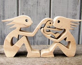 deux femmes un enfant ; sculpture bois