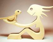 une femme un oiseau sculpture bois chantournée