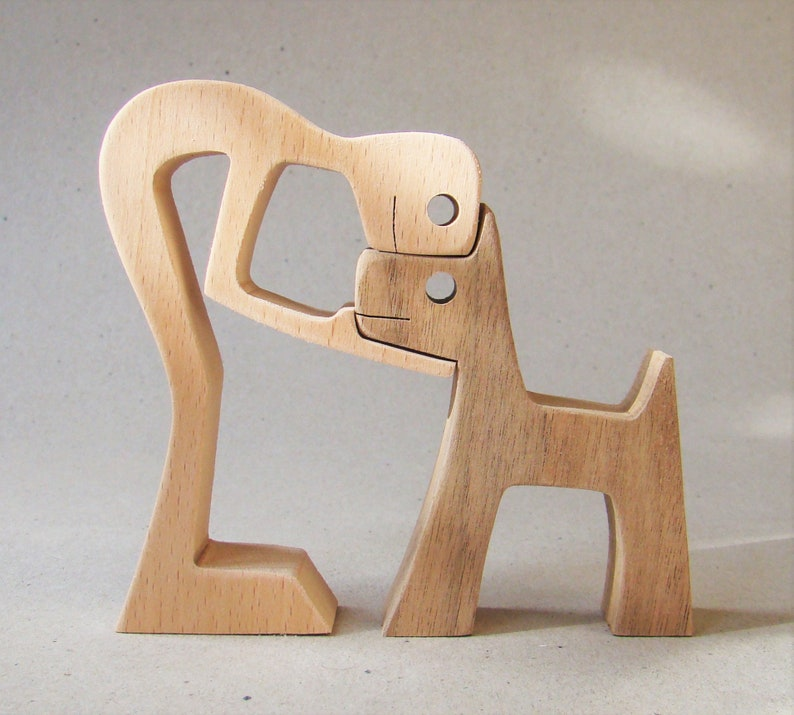 a man a dog sculpture wood fretted image 0