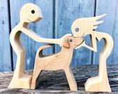 un couple un chien ; sculpture bois