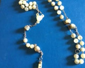 Vintage French rosary, mother of pearl cross and beads.