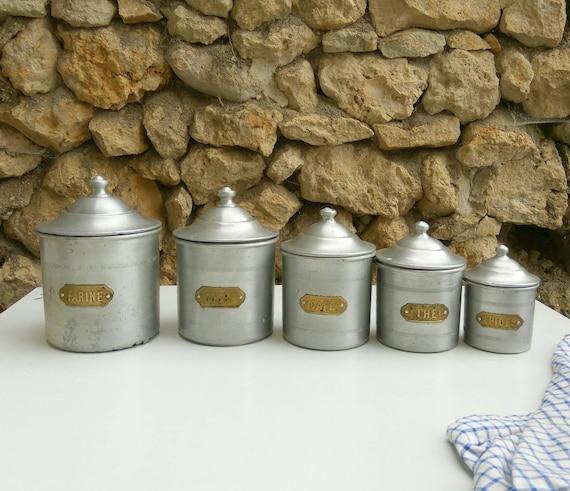 Vintage French aluminium kitchen storage jars. Brass labels.
