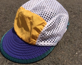 718afec9 Vintage Patagonia duckbill soft brim cycling hat - mesh yellow/purple lakers