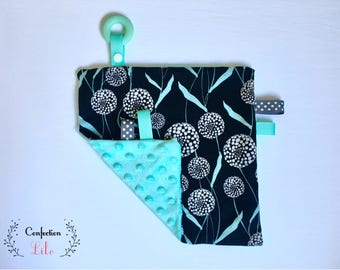 Taggy patterns turquoise on black background Option: ring silicone & paper rustling
