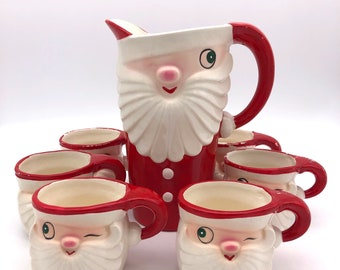Holt Howard Vintage Christmas Merry Whiskers Winking Santa Pitcher and 6 mugs