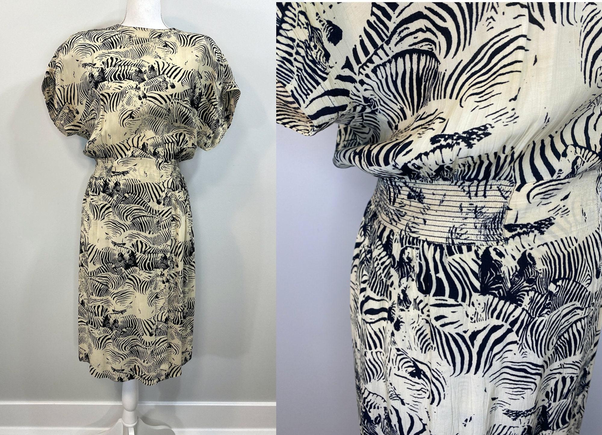 80s Dresses | Casual to Party Dresses Vintage 1980S Zebra Print Dress. Ivory Rayon With Print, Faux Wrap Skirt, Shoulder Pads. Elastic Smocked Waist. Liz Claiborne $0.00 AT vintagedancer.com
