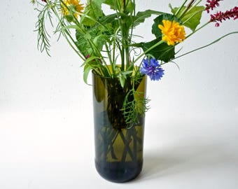 Flower vase from up-recycled wine bottle