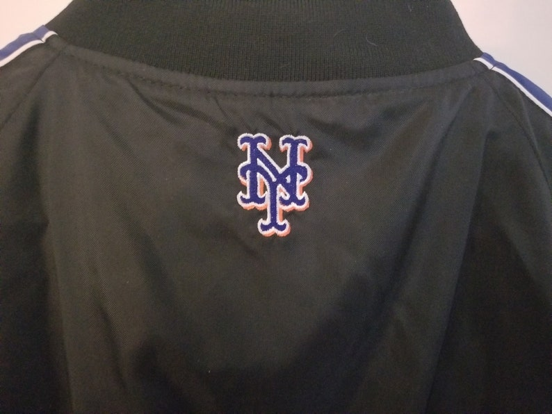 Vintage Off The Bench Size Medium 1980s New York Mets Zipper Down Black Jacket With Two Pockets And NY Logo On Back Baseball Jacket NY Mets