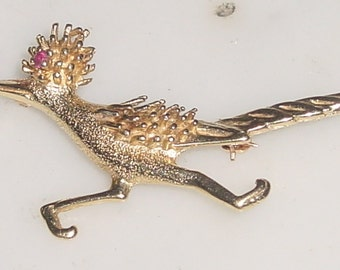 14K Gold Roadrunner Pin .2oz/5g weight on letter scale