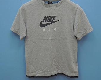465576d64746e Jahrgang Nike minimalistisches Logo Sport Polos Shirt Straße   Etsy