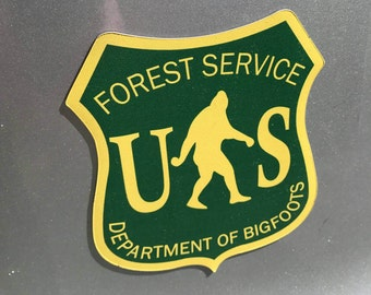 "National Forest Shield Bigfoot Sasquatch 5 "" Auto Magnet designed by Cliff Barackman"