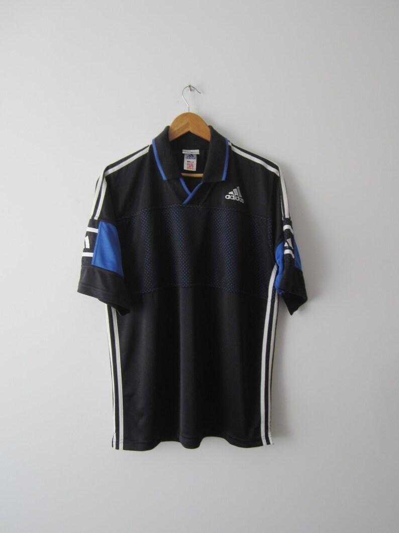 34c2147e45e4f Golf Tenis camisa camiseta tamaño mediano Adidas Vintage negro camiseta  deportes atletismo manga corta camisa para hombre