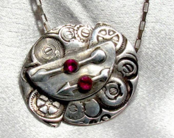 "Item 6018 - ""Point the Way""  Handcrafted, sculpted and carved  999 Fine Silver with Lab Grown Rubies"