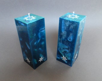Handmade Candles. Turquoise square candles decorated with glitter and holographic wax