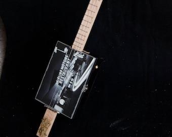 Custom built cigar box guitar featuring vintage photography