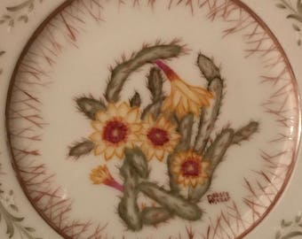 Handpainted flowering cactus on a decorative plate