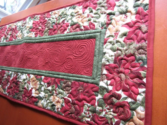 Rust Colored Poinsettia Quilted Table Runner Custom Quilted Table Pad Handmade Table Topper In Burnt Reds And Greens Table Setting