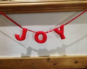 Handmade felt festive Christmas Joy letter bunting garland.