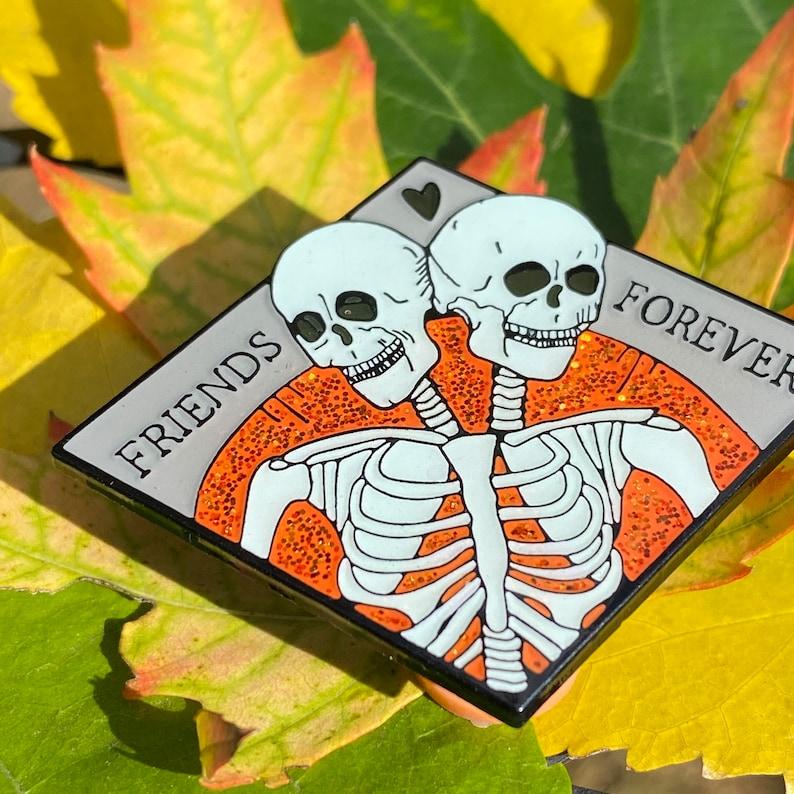 Pumpkin Variant Friends Forever enamel pin soft enamel glow in the dark spooky halloween pin flair conjoined twin skull Orange glitter