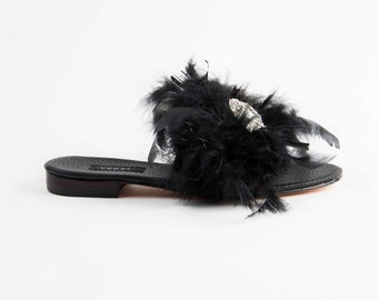 Leather sandals, with feathers and brooch with strass.