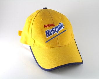 96612a19d10321 Vintage Nestle Nesquick Logo Yellow Dad Hat    Chocolate Flavored Milk  Advertising Baseball Cap with Adjustable Strapback