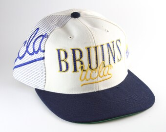 3f4b1cab854 Vintage 90 s UCLA Bruins Script Sports Specialties Snapback Baseball Cap     Deadstock - New without Tags    White   Blue Two-Toned Hat