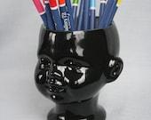 Doll head planter with open eyes black ceramic - flower vase hollow doll head