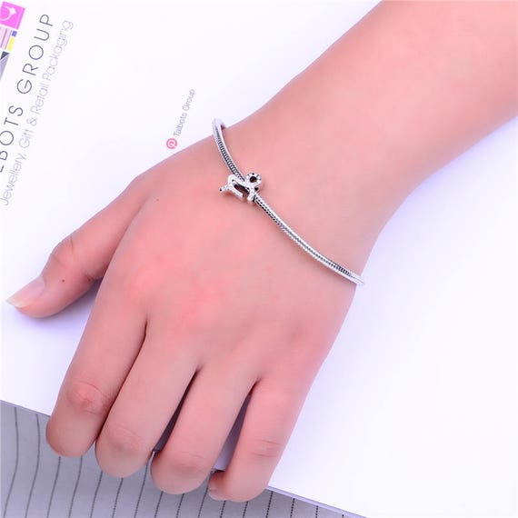 Sterling Silver 7 4.5mm Charm Bracelet With Attached Small Taurus Zodiac Horoscope Symbol Charm