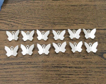 10 50 or 100 SILVER PLATED WHITE BUTTERFLY CRAFT CHARMS