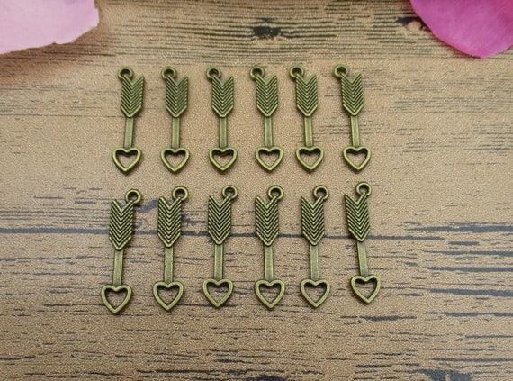 10 Arrow charms antique bronze tone BC1