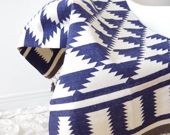 Handwoven navy and off-white rug with tassles and triangle pattern (dhurrie)