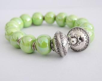 Apple green iridescent Olympus bracelet