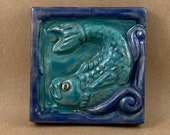 Square Fish Looking Left Tile (satin blue) (4 x 4 inch aprox)