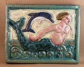 Merman with Dolphin (turquoise border, dawn sky)  (9 x 7.5 inch aprox)