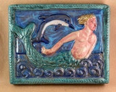 Merman with Dolphin 2 (teal border)  (9 x 7.5 inch aprox)