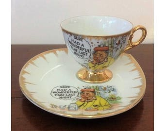 """Vintage Humorous Tennis Set """"Sure Had A Wonderful Time Last Night"""" Gold Gilt Porcelain Tea Cup & Saucer Made in Japan Funny Cartoon 1950's"""