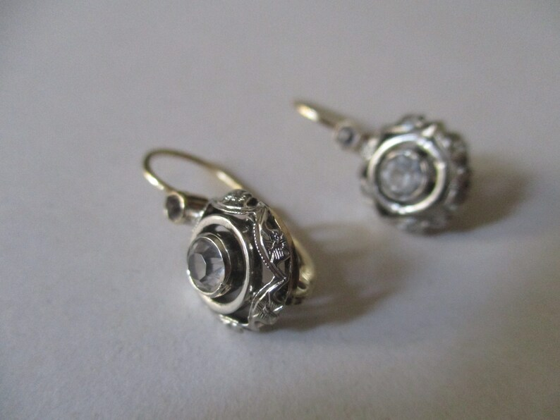 Old fashion style earrings in gold and silver