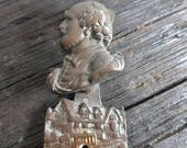 Antique bronze door knocker in form of a figure in good condition circa early 1930s