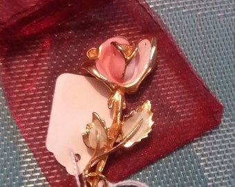 Gold tone flower brooch in gift pouch