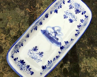 Lovely China trinket dish in blue and white design and stamped to base in very good condition