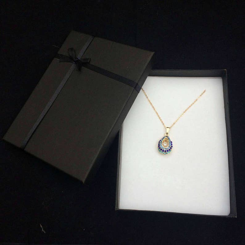 Lovely Gold tone chain and pendant with lovely blue and mixed colour crystals
