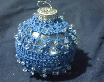 Beautiful crocheted Christmas tree ornament accented with clear beads