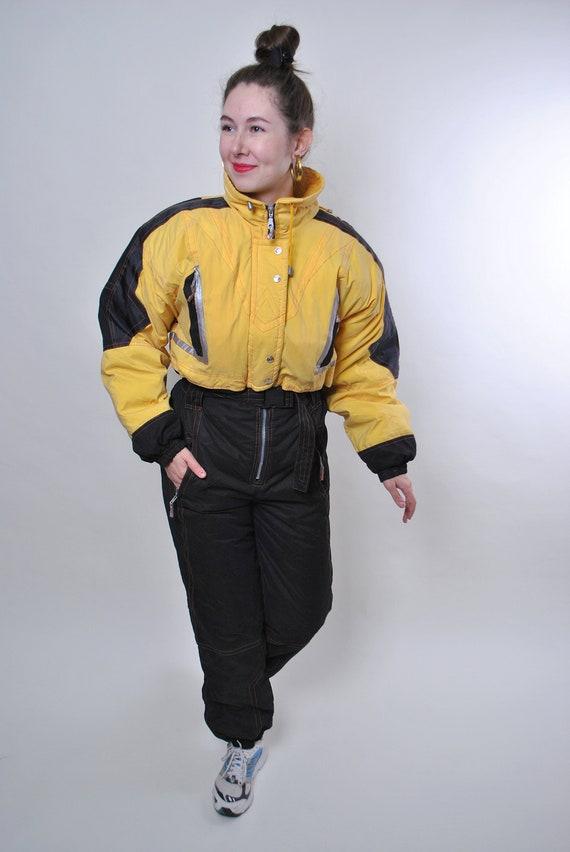Vintage yellow ski suit, one piece black snow suit