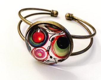 Bronze bracelet, multicolor, ink, glass cabochons.