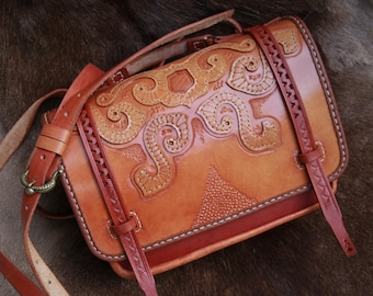 Shoulder bag with applications, made of cowhide leather