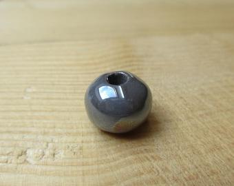 12 mm iridescent grey ceramic bead
