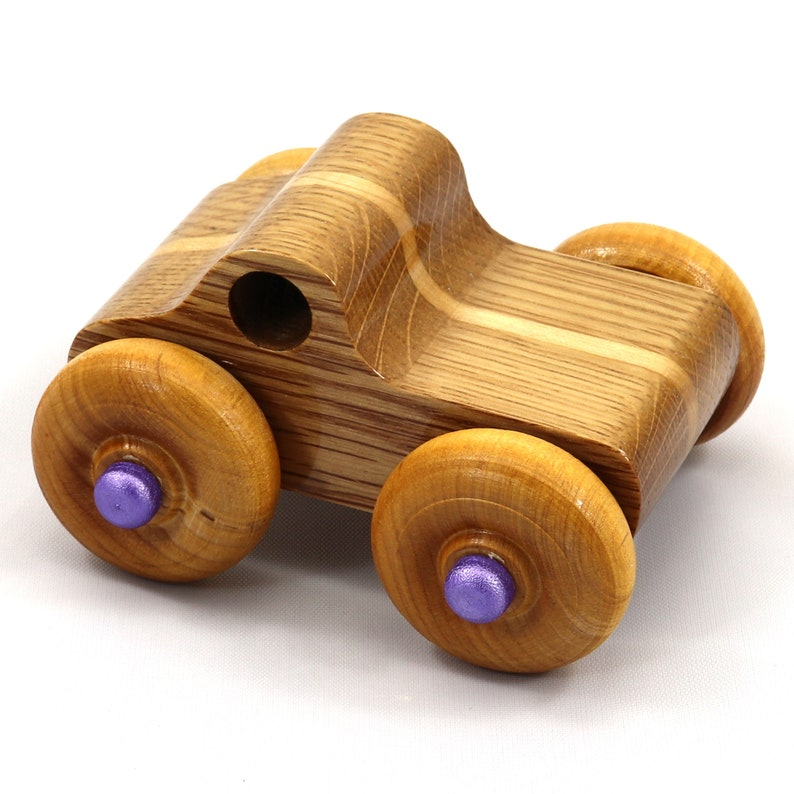 Wooden Toy Truck A Monster Truck based on the Pickup Truck in image 0