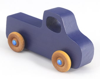 Small Wood Toy Pickup Truck Navy Blue With Metallic Blue Hubs from the Play Pal Series