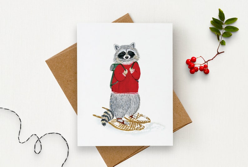 Winter Card with a raccoon snowshoeing  Raccoon wearing a image 0