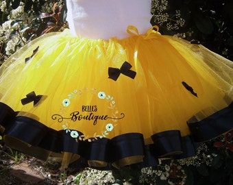 Yellow Tutu with small black bows and Ribbon Trim